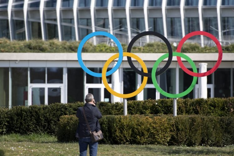 epa08302189 Olympic Rings are pictured in front of The Olympic House, headquarters of the International Olympic Committee (IOC), in Lausanne, Switzerland, 17 March 2020. The IOC is holding a series of teleconferences to discuss the latest developments on COVID-19 coronavirus pandemic impact on the Olympic Games Tokyo 2020. From 17 March 2020 until further notice, Switzerland's authorities proclaiming the state of necessity to fight against the spread of the SARS-CoV-2 coronavirus causing the Covid-19 disease.  EPA-EFE/LAURENT GILLIERON